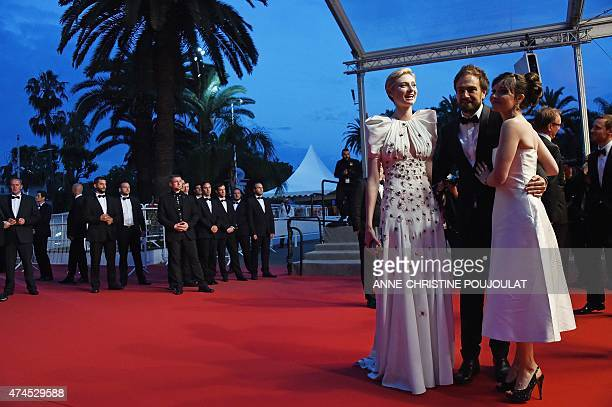 Australian director Justin Kurzel poses with his wife Australian actress Essie Davis and French actress Elizabeth Debicki before leaving the Festival...