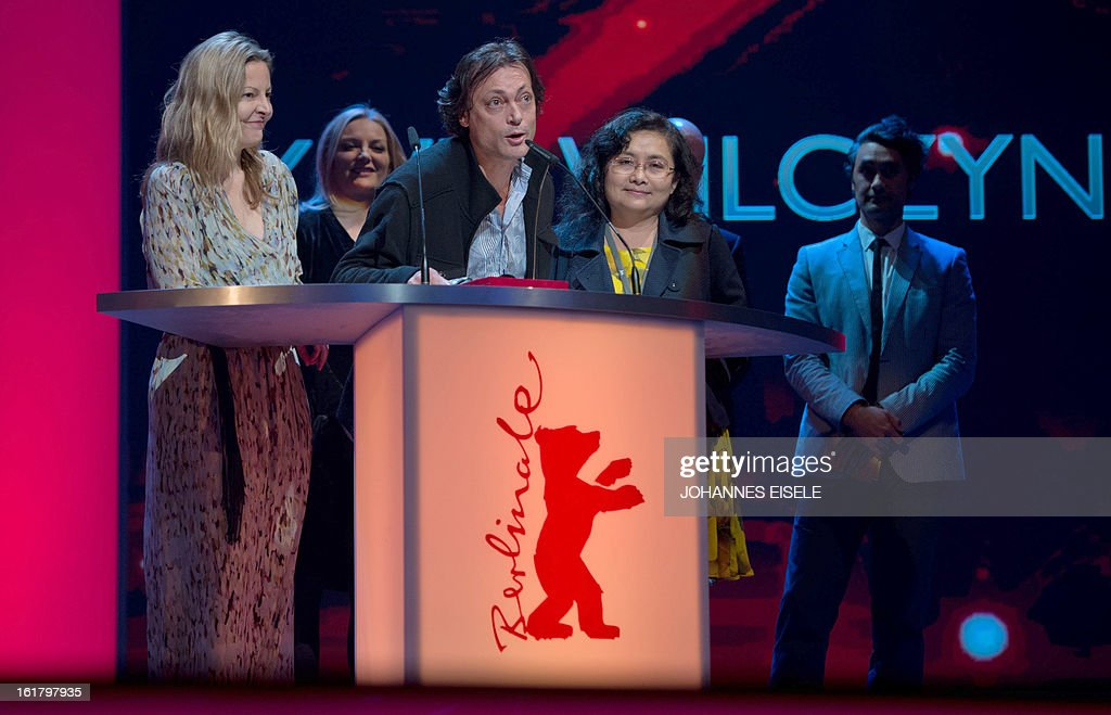 Australian director Kim Mordaunt (C) winner of the Best First Feature Award for the film 'The Rocket' delivers his speech next to producers Pauline Phayvanh Phoumindr (R) and Sylvia Wilcynski (L) during the awards ceremony of the 63rd Berlinale Film Festival on February 16, 2013 in Berlin.