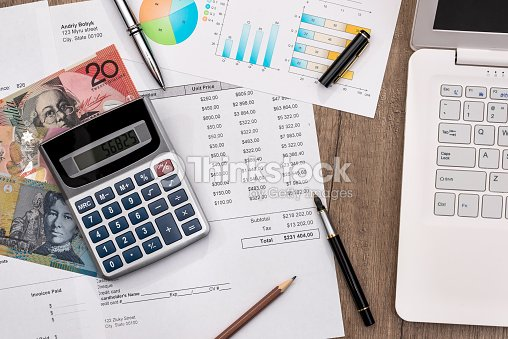 Australian Dollar With Graph Home Budget Laptop And Calculator Stock Photo