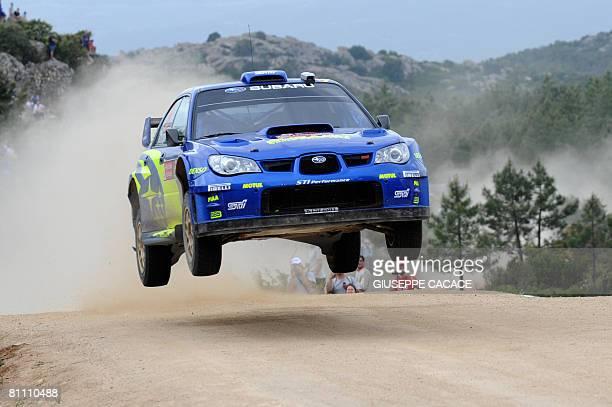 Australian driver Chris Atkinson and his Belgian codriver Stephane Prevot clear a hump with their Subaru Impreza WRC during the Terranova special...