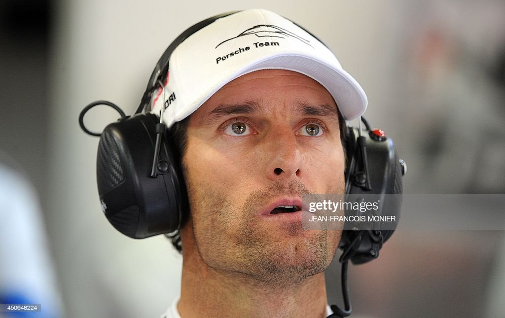 Australian driver Mark Webber (Porsche 919 Hybrid N° 20) is seen in his pit during the 82nd Le Mans 24 hours endurance race, on June 15, 2014 in Le Mans, western France. Fifty-six cars with 168 drivers are participating on June 14 and 15 in the Le Mans 24-hours endurance race.