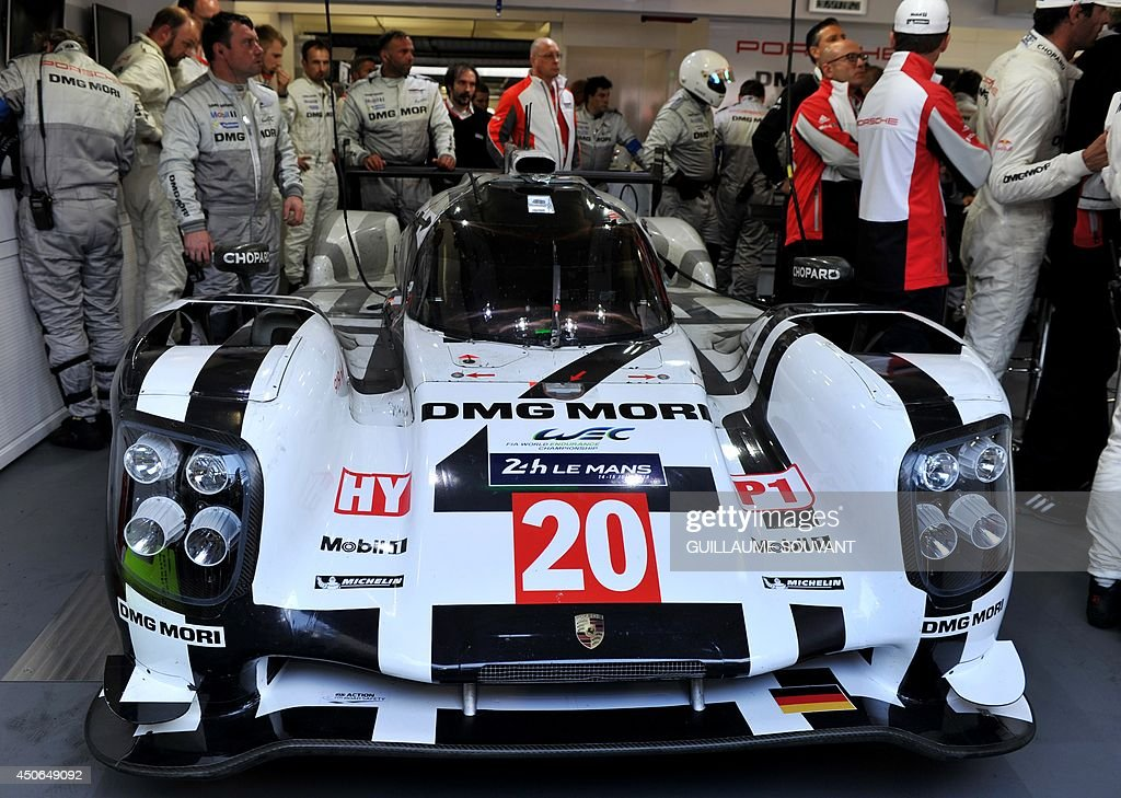 Australian driver Mark Webber's Porsche 919 Hybrid N° 20 in the paddock during the 82nd edition of the Le Mans 24-hours (24 Heures du Mans) endurance race, on June 15, 2014 in Le Mans, western France. Austrialian former Formula One ace Mark Webber was leading the Le Mans 24 Hours endurance race with just three hours to go today after cashing in on the Audi team's misfortunes.