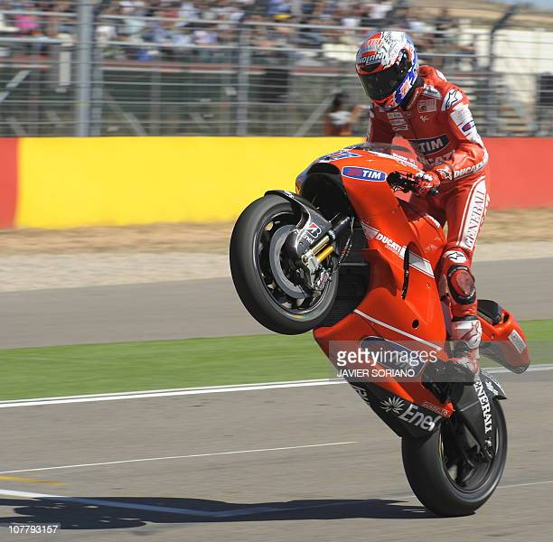 Australian Ducati Team Casey Stoner celebrates after winning the MotoGP race of the Aragon Grand Prix at Motorland's racetrack in Alcaniz on...