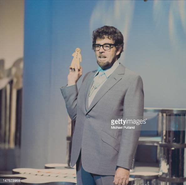 Australian entertainer Rolf Harris holding a gingerbread man during a television appearance London 1969