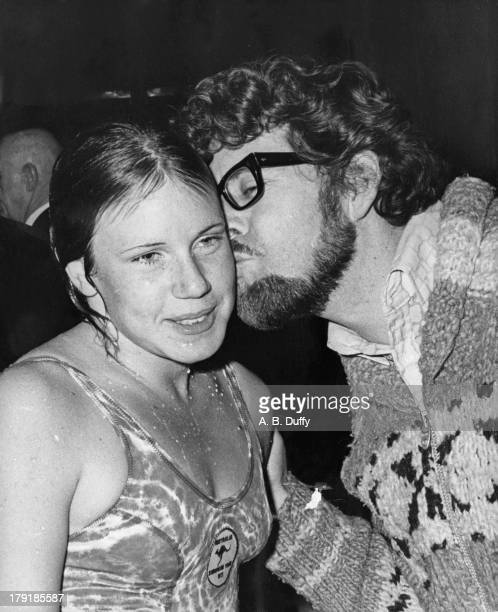Australian entertainer Rolf Harris kissing 17yearold Australian swimming champion Karen Moras after she broke the world record for the 400 Metres...