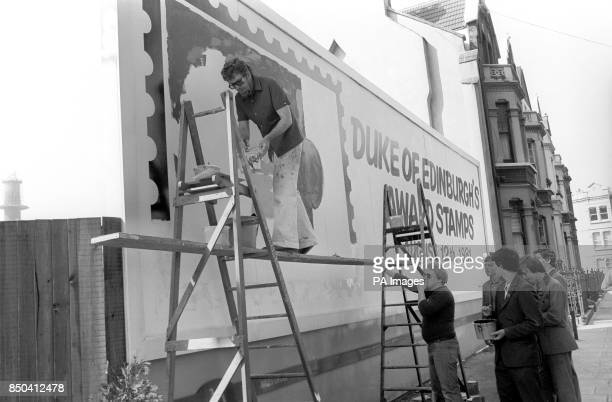 Australian entertainer Rolf Harris on the verge of completing a giant painting the largest of a postage stamp ever painted on a London billboard The...