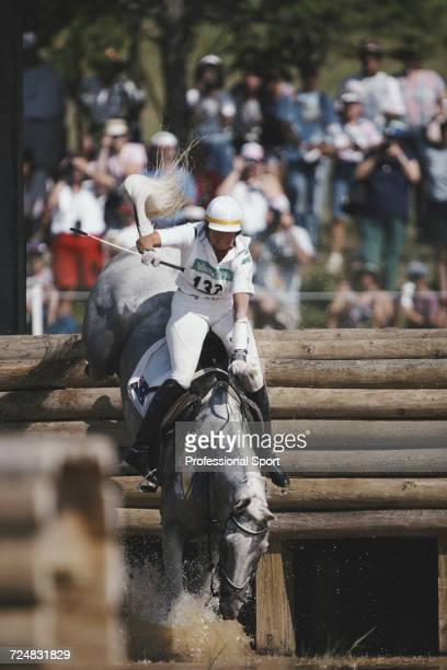 Australian equestrian Gillian Rolton rides Peppermint Grove to fall at the water hazard in the Cross Country discipline during competition for the...