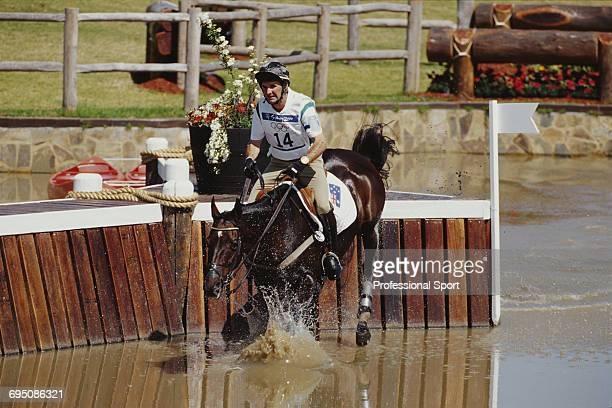 Australian equestrian Phillip Dutton competes on House Doctor for the Australia team to finish in first place to win the gold medal in the Team...