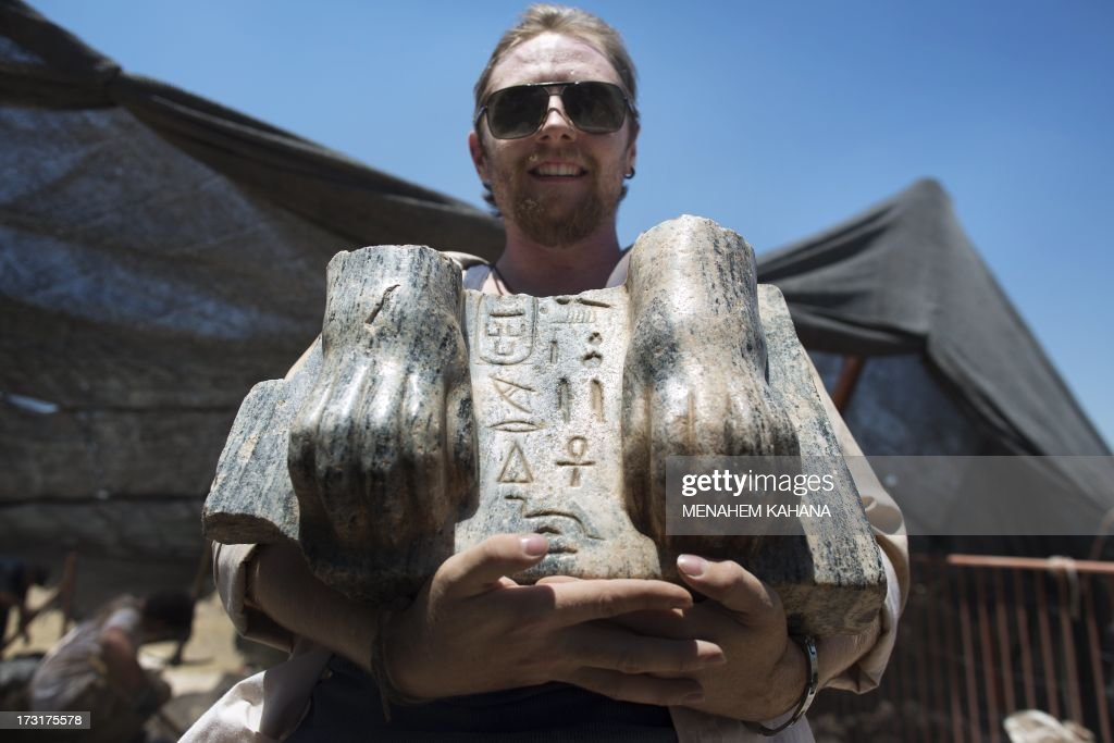 Australian excavation volunteer Joshua Talbot displays the remains of a Sphinx with a hieroglyphic inscription between its paws dating circa 3rd century BCE, found during excavation in the Northern Israeli archeological site of the ancient Tel Hazor, revealed on July 9 2013. The Sphinx was sculpted for Egyptian King Mycerinus, one of the builders of the Giza pyramids, and this is the first time ever a statue dedicated to Mycerinus has been uncovered, and the first time such a finding has been unearthed in the Levant.
