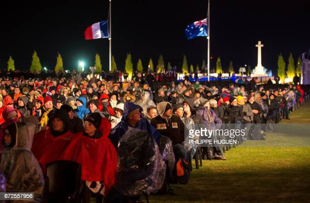 Australian family members wait for the dawn ceremony to start at the military cemetery of the Australian National Memorial in VillersBretonneux...