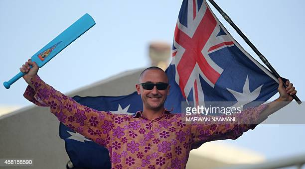 STORY Australian fan Luke Gallian waves his country's flag during Australia's first One Day International against Pakistan in the United Arab...