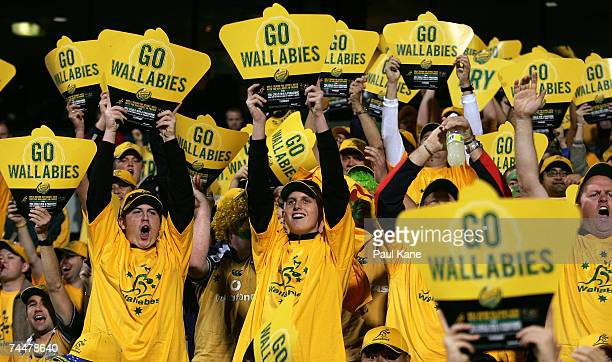 Australian fans celebrate a try during the Test match between the Australian Wallabies and Fiji at Subiaco Oval June 9 2007 in Perth Australia