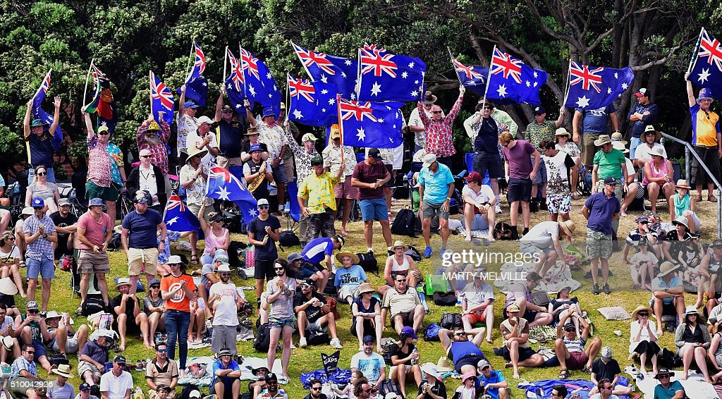 Australian fans celebrate Adam Voges of Australia's 200 runs during day three of the first cricket Test match between New Zealand and Australia at the Basin Reserve in Wellington on February 14, 2016. / AFP / Marty Melville