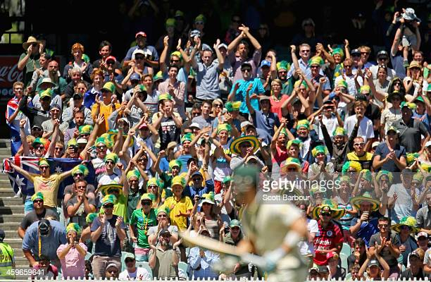Australian fans cheer as the winning runs are hit and Australia wins the match during day four of the Fourth Ashes Test Match between Australia and...