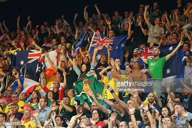 Australian fans enjoy the atmosphere during the Women's Basketball Preliminary Round match between Australia and France on day 3 of the London 2012...