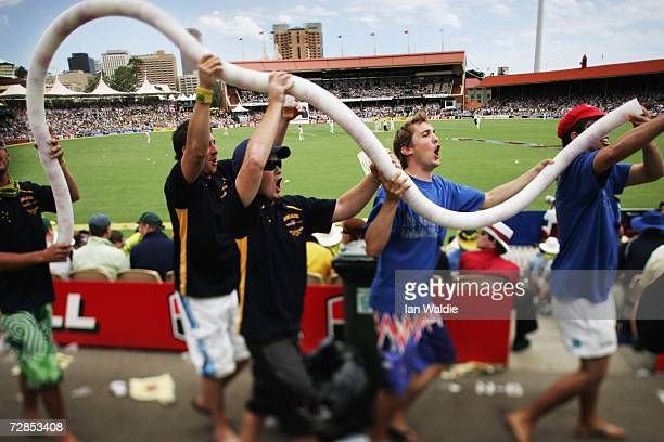Australian fans form an illicit 'beer snake' made from empty beer cups on 'The Hill' at the Adelaide Oval cricket ground during the second Ashes test...