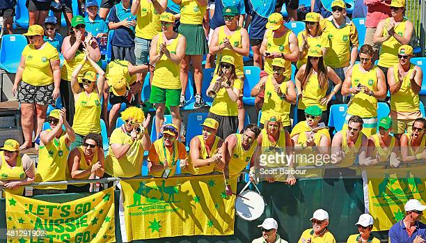 Australian fans in the crowd show their support during the reverse singles match between Lleyton Hewitt of Australia and Aleksandr Nedovyesov of...