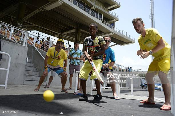 Australian fans play a pick up game of street cricket in the spectator stands with local children on day four of the second cricket Test between...