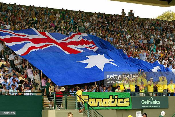 Australian fans roll out a large flag during the Davis Cup tennis tie between Australia and Sweden in Adelaide 06 February 2004 Lleyton Hewitt of...