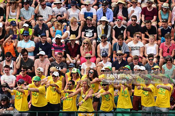 Australian fans show their support for Nick Kyrgios of Australia as he competes in his Gentlemens Singles Second Round match against Juan Monaco of...
