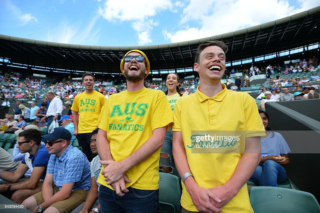 Australian fans take their places in the crowd on No 1 Court where Australia's Sam Groth will play Japan's Kei Nishikori during their men's singles first round match on the first day of the 2016 Wimbledon Championships at The All England Lawn Tennis Club in Wimbledon, southwest London, on June 27, 2016. / AFP / GLYN