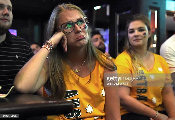 Australian fans watch on November 1 the Australian Wallabies lose to the New Zealand All Blacks on a big screen in a Sydney sports bar during the...