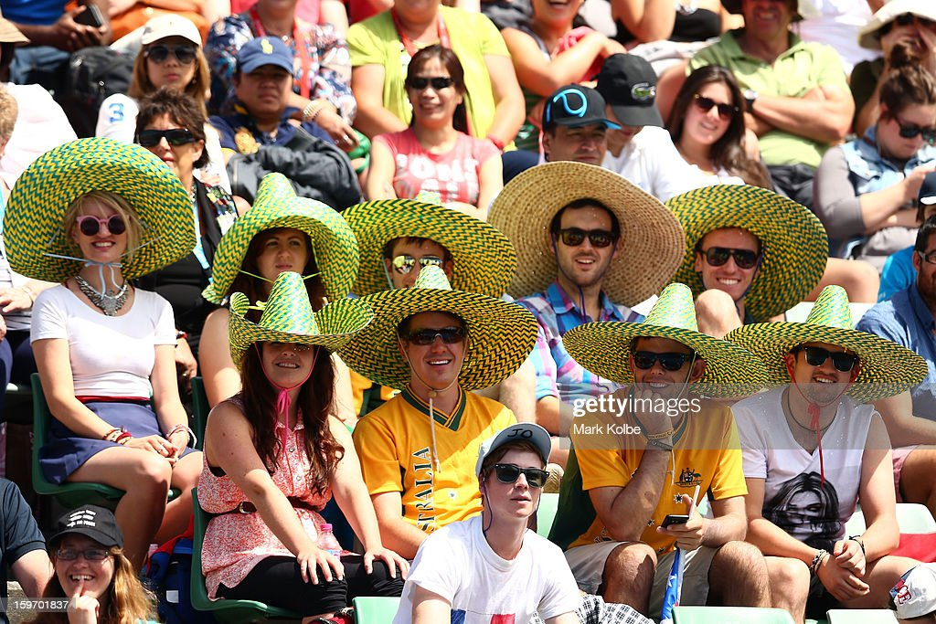 Australian fans watch the legends doubles round one match between Todd Woodbridge of Australia and Mark Woodforde of Australia and Wayne Ferreira of South Africa and Mansour Bahrami of Iran during day six of the 2013 Australian Open at Melbourne Park on January 19, 2013 in Melbourne, Australia.