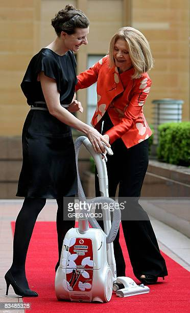 Australian fashion designer Carla Zampatti and her daughter Allegra Spender show off their specially designed Hoover vacuum cleaner in Sydney on...