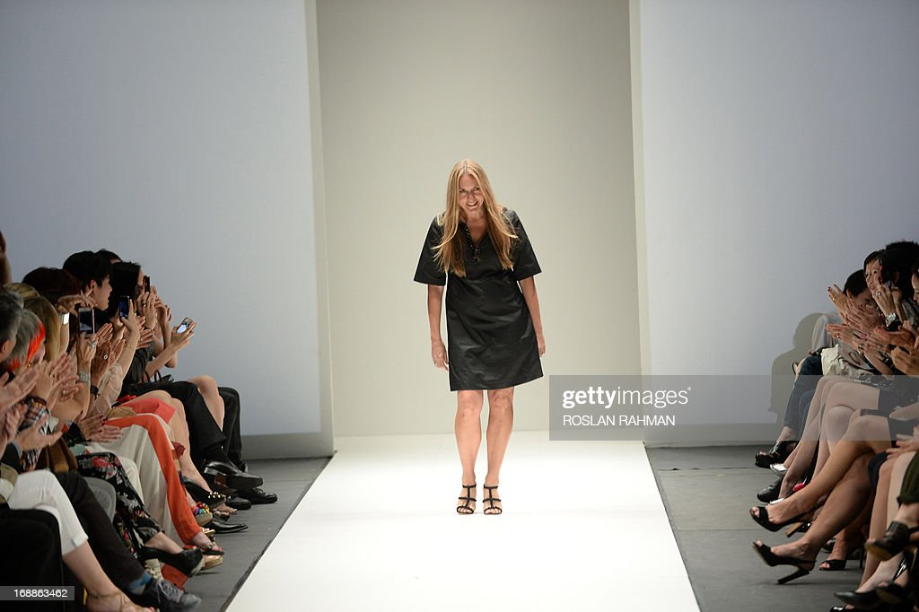 Australian fashion designer Collette Dinnigan acknowledges the audience after presenting her fashion creation for the Autumn/Winter 2013 collection...