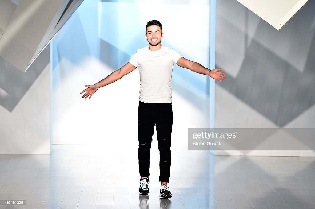 Australian fashion designer Johnny Schembri thanks the audience after the By Johnny show during Mercedes-Benz Fashion Week Australia 2014 at Carriageworks on April 7, 2014 in Sydney, Australia.