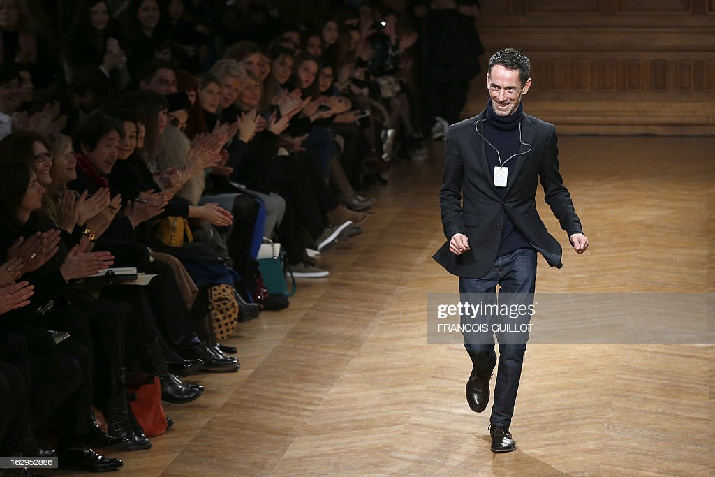 Australian fashion designer Martin Grant acknowledges the public at the end of his Fall/Winter 2013-2014 ready-to-wear collection show, on March 2, 2013 in Paris.