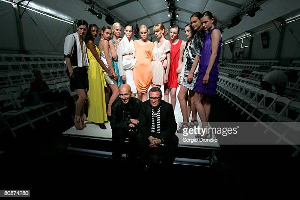 Australian Fashion Week founder Simon Lock and fashion designer Jayson Brunsdon pose with a group of thirteen models dressed in preview outfits from...