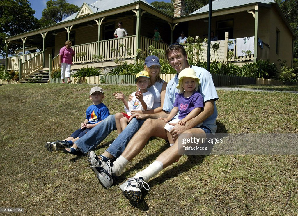 Australian fast bowler Glenn McGrath has watches play during a game of cricket between Sutherland and Fairfield at Caringbah Oval with wife Jane...