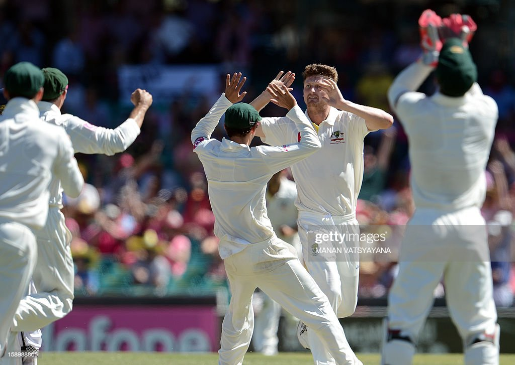 Australian fast bowler Jackson Bird (2R) celebrates with teammates after taking the wicket of unseen Sri Lankan batsman Dimuth Karunaratne on day three of the third cricket Test match between Australia and Sri Lanka at the Sydney Cricket Ground on January 5, 2013.