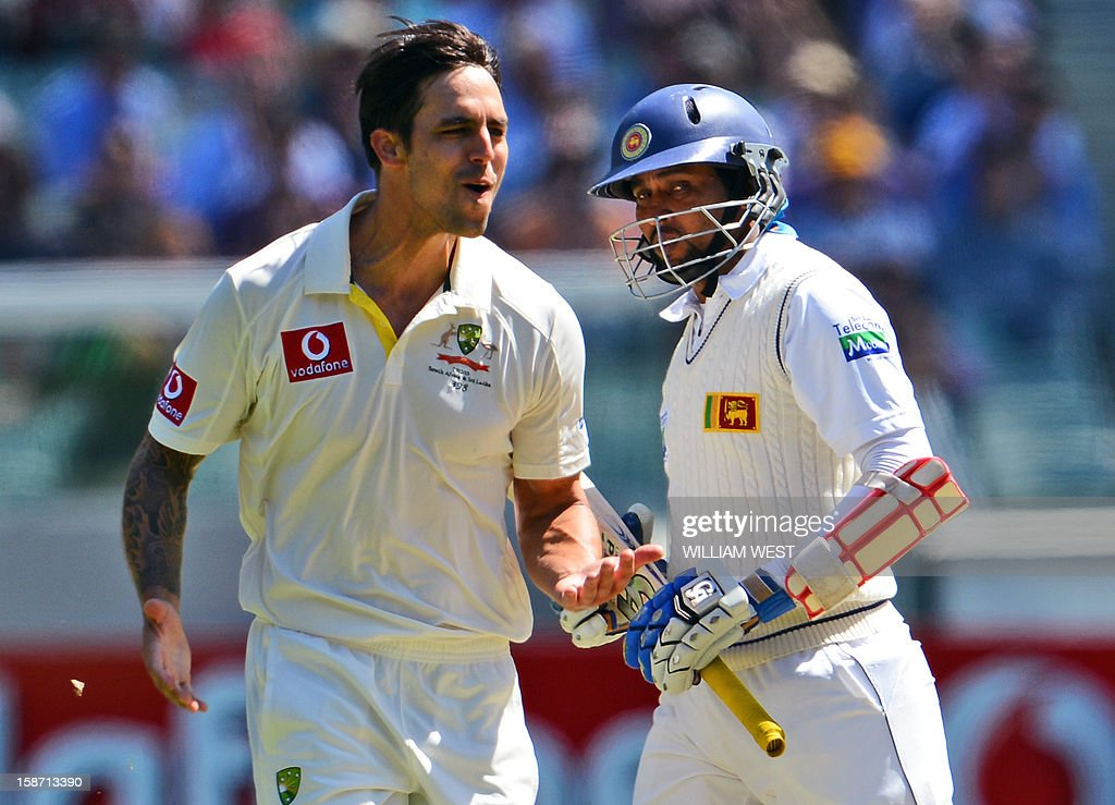 Australian fast bowler Mitchell Johnson (L) celebrates dismissing Sri Lankan batsman Tillakaratne Dilshan (R) on the first day of the second cricket Test match between Australia and Sri Lanka at the Melbourne Cricket Ground (MCG), in Melbourne, on December 26, 2012. AFP PHOTO/William WEST IMAGE RESTRICTED TO EDITORIAL USE - STRICTLY NO COMMERCIAL USE