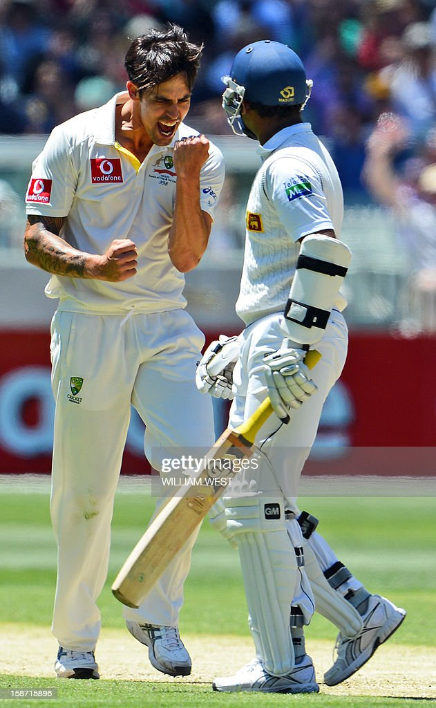 Australian fast bowler Mitchell Johnson (L) gestures after believing he has Sri Lankan batsman Prasanna Jayawardene (R) out before the decision is over-ruled on the first day of the second cricket Test match between Australia and Sri Lanka at the Melbourne Cricket Ground (MCG), in Melbourne, on December 26, 2012. AFP PHOTO/William WEST IMAGE