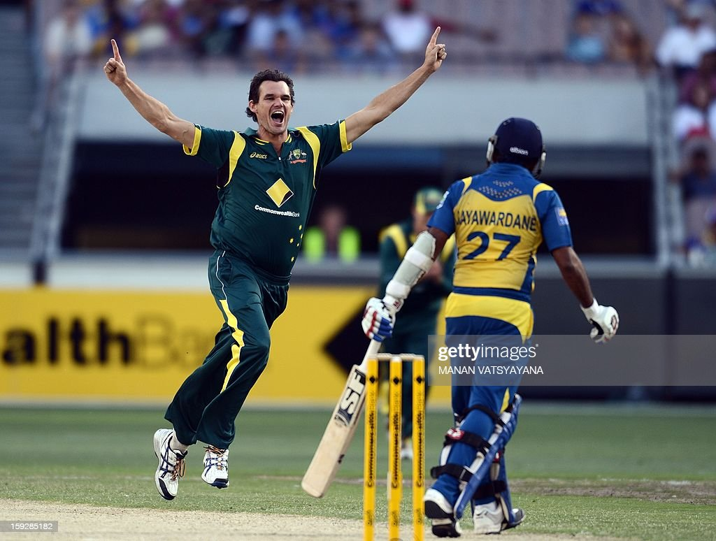 Australian fastbowler Clint Mckay (L) celebrates after taking the wicket of Srilankan captain Mahela Jayawardena (R) during the first one-day international between Australia and Sri Lanka at the Melbourne Cricket Ground on January 11, 2013. AFP PHOTO/ MANAN VATSYAYANA USE