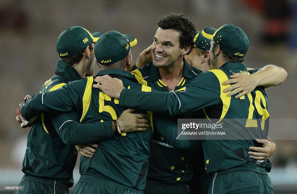 Australian fastbowler Clint Mckay (C) celebrates with teammates after taking the wicket of unseen Sri Lankan batsman Ajantha Mendis during the first one-day international between Australia and Sri Lanka at the Melbourne Cricket Ground on January 11, 2013.