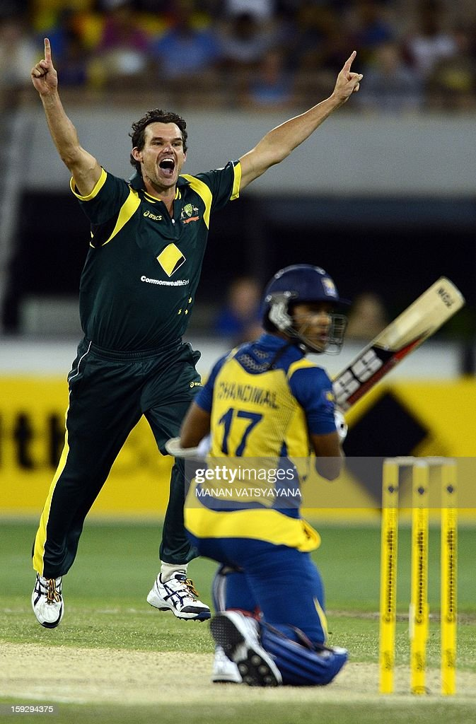 Australian fastbowler Clint Mckay (L) reacts after taking the wicket of Sri Lankan batsman Dinesh Chandimal during the first one-day international between Australia and Sri Lanka at the Melbourne Cricket Ground on January 11, 2013. AFP PHOTO/ MANAN VATSYAYANA USE