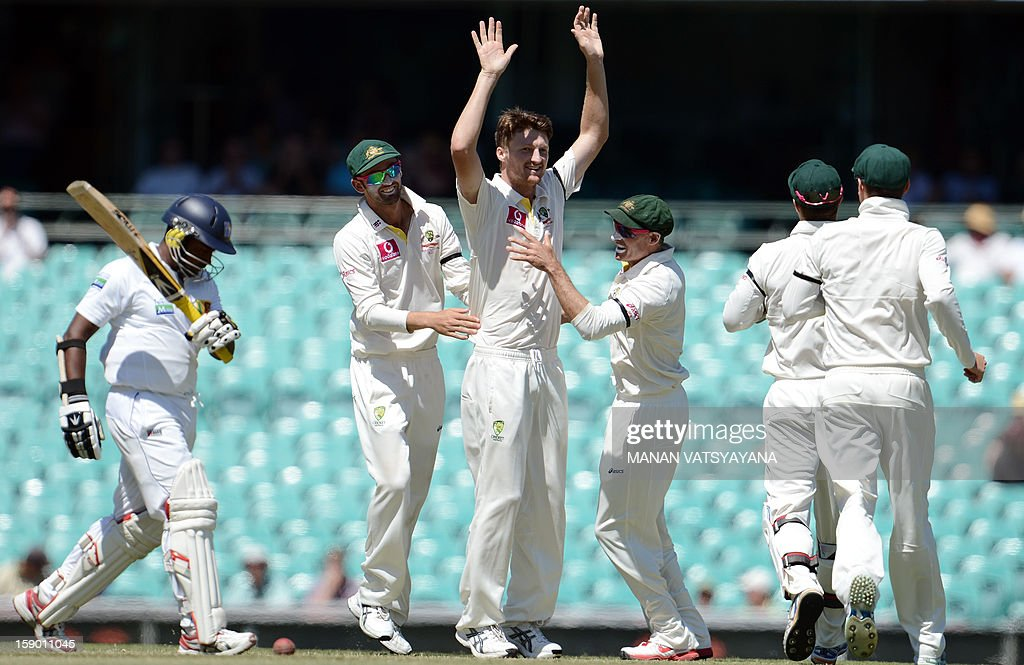 Australian fastbowler Jackson Bird (C) celebrates with teammates after taking the wicket of Sri Lankan batsman Rangana Herath on the fourth day of the third cricket Test match between Australia and Sri Lanka at the Sydney Cricket Ground on January 6, 2013.