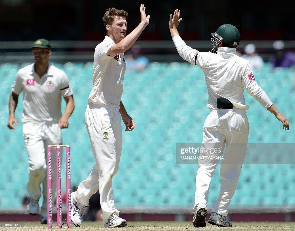 Australian fastbowler Jackson Bird (C) celebrates with teammates after taking the wicket of unseen Sri Lankan batsman Nuwan Pradeep on the fourth day of the third cricket Test match between Australia and Sri Lanka at the Sydney Cricket Ground on January 6, 2013.