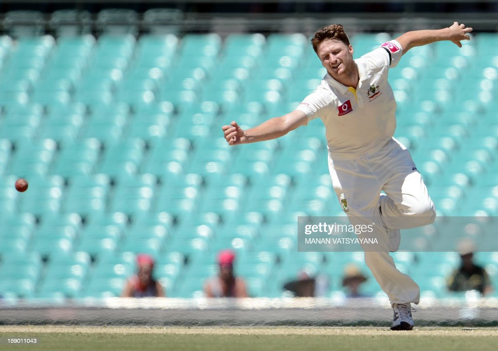 Australian fastbowler Jackson Bird tries to stop a shot off his bowling on the fourth day of the third cricket Test match between Australia and Sri Lanka at the Sydney Cricket Ground on January 6, 2013.