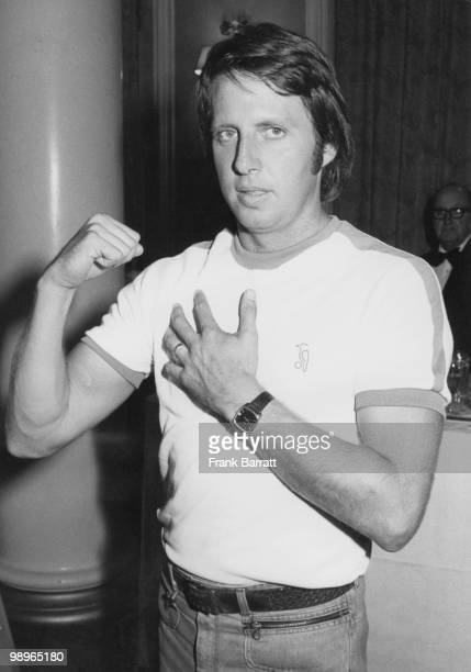 Australian fastbowler Jeff Thomson flexes his injured right shoulder at a press conference at the Waldorf Hotel London 22nd April 1977 The Australian...