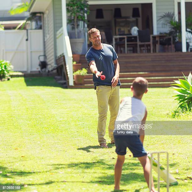 Australian father and son playing cricket