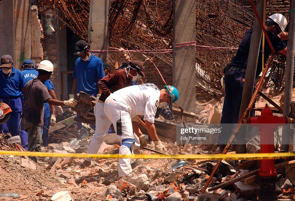 Australian Federal Police and Indonesian investigators dig through the rubble at the site of the nightclub bombing October 24, 2002 in Bali, Indonesia. The blast occured in the popular tourist area of Kuta October 12, 2002 leaving more than180 people dead and132 injured, the majority being tourists.