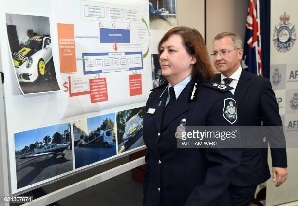 Australian Federal Police Deputy Commissioner Leanne Close leaves a press conference with Australian Taxation Office Acting Commissioner of Taxation...