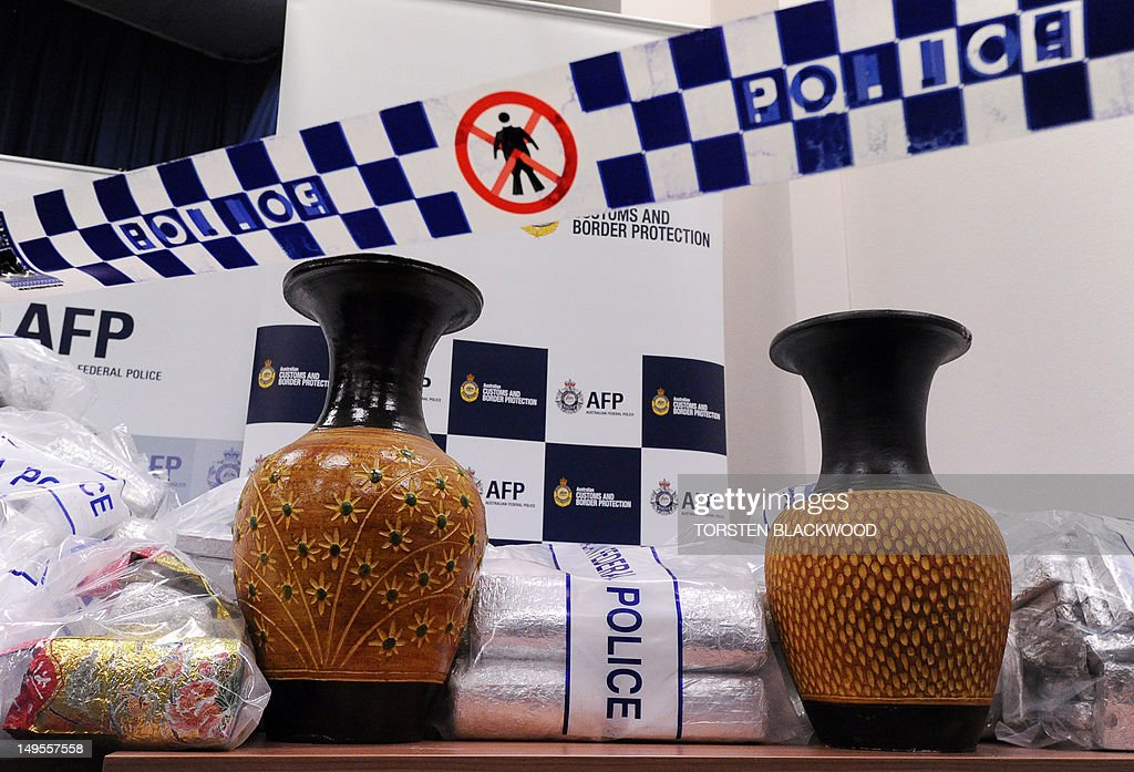 Australian Federal Police (AFP) display ceramic vases used to conceal 525 million USD worth of crystal methamphetamine ('ice') and heroin after smashing a Hong Kong-based international drugs syndicate in Sydney on July 31, 2012. It was the largest haul of ice (306 kilograms) in Australian history and the third-biggest heroin bust (252 kilograms) and was the culmination of an 11-month operation following a tip-off from the US Drug Enforcement Administration. AFP PHOTO / Torsten BLACKWOOD