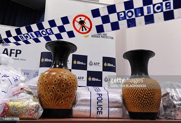 Australian Federal Police display ceramic vases used to conceal 525 million USD worth of crystal methamphetamine and heroin after smashing a Hong...