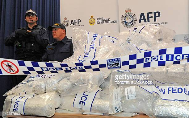 Australian Federal Police guard 525 million USD worth of crystal methamphetamine and heroin after smashing a Hong Kongbased international drugs...
