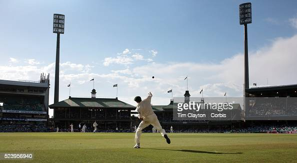 Australian fielder Michael Hussey throws the ball after fielding near the boundary at the Sydney Cricket Ground during day two of the third test...